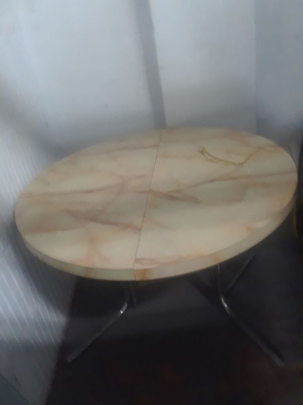 Nice small kitchen table, with three chairs