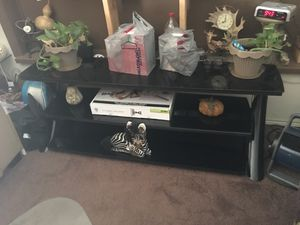 Black glass TV stand for Sale in Phoenix, AZ