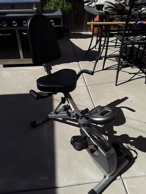 Exercise bike slight cracked on gauge with works fine can b folded for storage for Sale in Glendora, CA