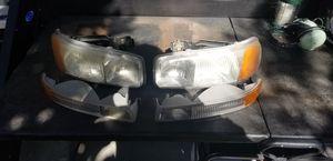 99-06 gmc sierra headlights w/ bulbs for Sale in Oceanside, CA