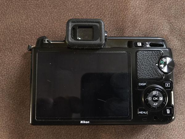 Nikon 1 V1 Mirrorless Digital Camera Body and more