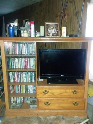 Wood entertainment center tv and movies don't come with it for Sale in Oak Grove, LA
