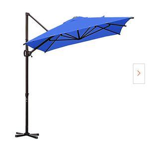 9 ft. x 7 ft. Offset Cantilever Adjustable Vertical Tilt Patio Umbrella in Sand(blue 58lb) for Sale in Ontario, CA