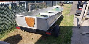 I have a 10 foot aluminum boat comes with oars and it has a trailer with lights and a spare, for Sale in Portland, OR