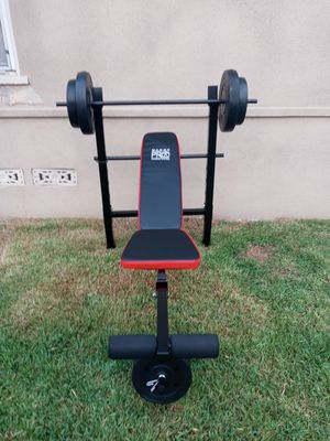 Marcy adjuntable standard workout incline decline flat bench which 100lbs wieghts include. Brand new in box for Sale in Long Beach, CA