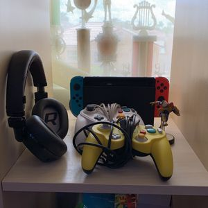 Nintendo Switch With Super Smash Bro's 2 Controllers Hd Audio Headsets And A Captain Falcon Amibo for Sale in Miami, FL