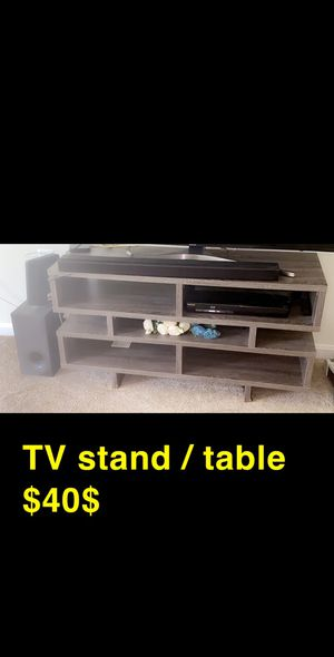TV STAND/ table fits 55' or 65' tv for Sale in Rockville, MD