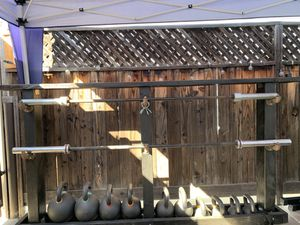Men and Woman weight lifting bar. for Sale in Long Beach, CA