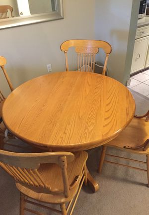 Oak dining room extendable table set and 4 chairs for Sale in Bothell, WA