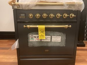 "ILVE Nostalgie Series 30"" 3 cu.ft. Freestanding Duel Fuel Range in matte graphite/ Brass. Brand new gas cooktop with electric stove (dual fuel). for Sale in Denver, CO"
