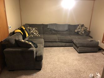 Brown suede 2 piece sectional sofa with throw pillows with chase. Chase can be moved. for Sale in Iowa City,  IA
