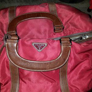 Real Authentic Original Prada Luggage Duffle Bag Burgundy for Sale in Las Vegas, NV
