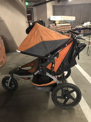 BOB Double Revolution Duallie Jogging Stroller- tear in footrest pictured for Sale in Los Angeles, CA