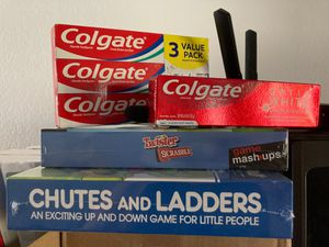 Chutes and ladders retro board game + twister x scrabble board game + Colgate toothpaste for Sale in Fountain Valley, CA