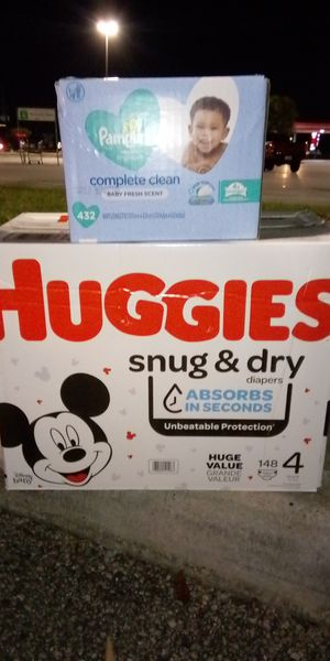 Brand New case of Huggies snug and dry size 4 comes with a case of pampers wipes! for Sale in Spring, TX