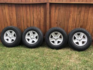 17 inch OEM jeep wheels and tires for Sale in League City, TX