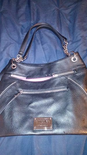 The purse is Nicole Miller brand new never used. The two backpacks are Walmart brand brand new never used for Sale in San Diego, CA