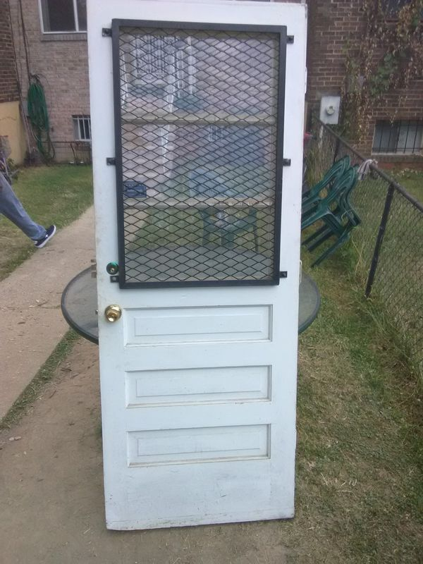 "82"" x 32"" Exterior Security Door with Stainless Steel grate, door knob fixtures,hinges, and lock fixture with keys"