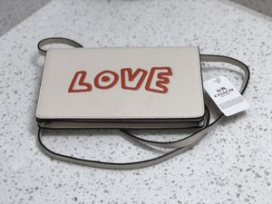 """COACH X KEITH HARING """"Love"""" Leather Fold Over Clutch Crossbody Bag for Sale in Seattle, WA"""