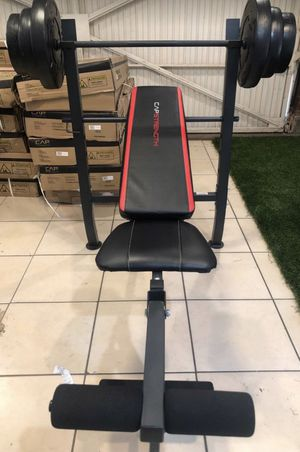 Bench press combo with leg developer and barbell and 100 lb Weight Set for Sale in Montebello, CA