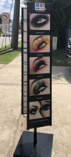 """Great condition, 5' 3"""" spinning Display rack w/ hooks for Sale in Pinellas Park, FL"""
