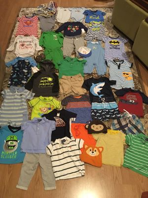 Baby boy 6-9 month clothes. 33 items of clothing, a pair of camouflage slippers, 3 hats and 12 hangers for Sale in Corinna, ME