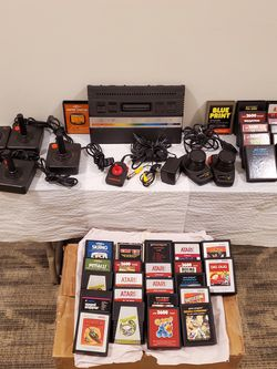 VINTAGE ATARI 2600 with 34 GAMES, FIVE (5) JOY STICKS, & TWO (2) PADDLES - firm price. for Sale in Arlington,  VA