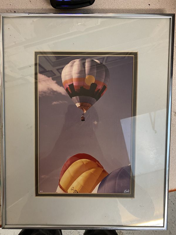 Professionally framed photo of hot air balloons in the sky by Loel Martin photography