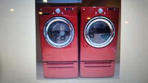 LG STEAM WASHER AND ELECTRIC DRYER SUPERCAPACITY WITH PEDESTALS for Sale in Hialeah, FL