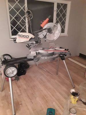 """Ridgid 12"""" Dual bevel compound Sliding mitre saw with stand for Sale in Pittsburgh, PA"""