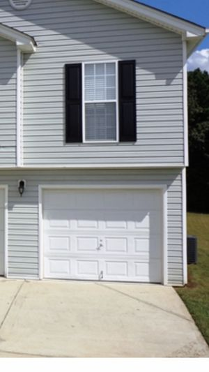 Used garage door and hardware for Sale in Winder, GA