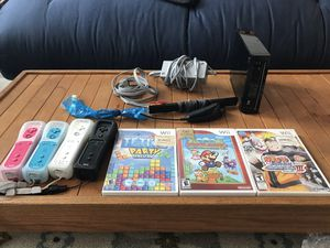 Nintendo Wii w/3 games, 4 Wii Remotes, and all connections included for Sale in Austin, TX
