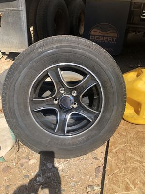 Brand new set of 5 rims and tires 205.75.14 Goodyear load D trailer lug nuts and center cap included for Sale in Peoria, AZ