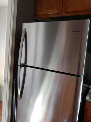 Frigidaire Refrigerator 18 cu ft. Frigidaire gas stove . both stainless with black. for Sale in Henderson, NV