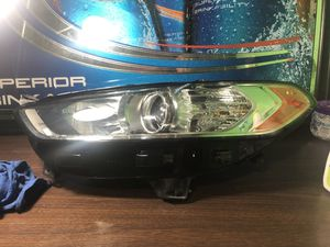 2014 Ford Fusion front headlight left and right for Sale in Wichita, KS
