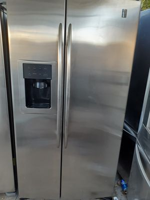 GE side-by-side stainless steel fridge for Sale in Phoenix, AZ