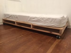 Twin bed frame (mattress not included) on casters with storage for Sale in Gig Harbor, WA