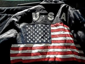 Itialian heavy leather mens xx large motorcycle jacket with usa and flag on the back for Sale in Long Beach, CA