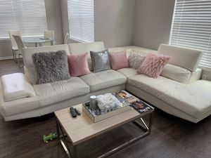 White leather couch, 3 years old. Originally from rooms to go. The rip can be fixed easily, due to that the price is negotiable for Sale in Houston, TX