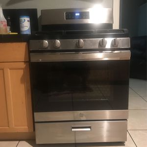 Stainless steel GE Gas Stove and LG Microwave. for Sale in Ontario, CA