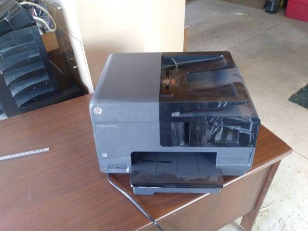 Desk, file cabinets, ink jet pro printer, shelves.