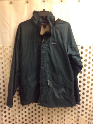 patagonia rain jacket Waterproof windbreaker Men XL dark Forrest emerald green color Only flaw is at the hood, see photos. Priced accordingly for Sale in Federal Way, WA