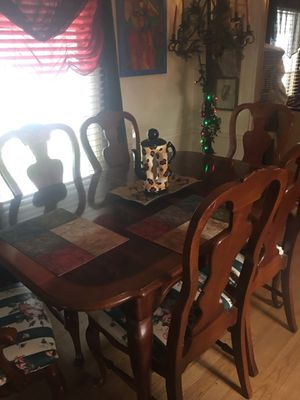 Beautiful dining room table cherry wood six cherry wood chairs are carved and designed beautiful pattern has a centerpiece for more company this Dine for Sale in Pompano Beach, FL