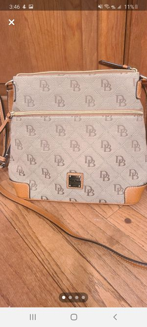 Authentic Dooney and Bourke cross body bag for Sale in North Ridgeville, OH