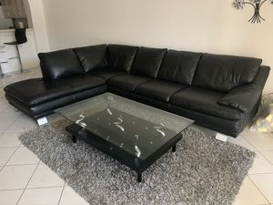 Cozy Black leather sofa with coffee table included for Sale in Miami, FL