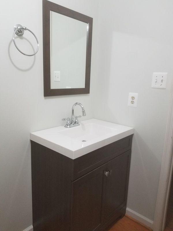 Vanity w/mirror and towel holder