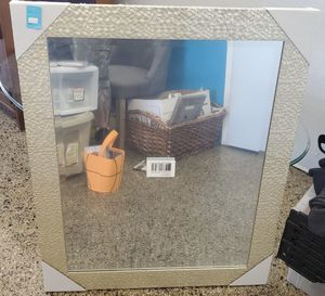 """Brand new wall mirror . Covered still in the plastic . 33 inches in height by 27"""" inches in the width . 45.00 obo for Sale in Fresno, CA"""