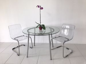 Glass table and 2 acrilic chairs great condition for Sale in Delray Beach, FL