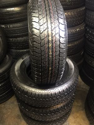 Set used tires 265/70/17 DUNLOP SEMI NEW 95% TREAD LIFE $300 INCLUDE PROFESSIONAL INSTALLATION AND TAX for Sale in Pico Rivera, CA