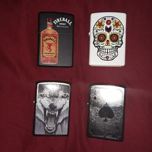 Selling ALL!! Lot of 4 NEVER used or carried Zippo lighters. Seal on back not broken for Sale in Elyria, OH